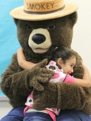 ECEC kindergartners each hugged Smokey Bear after the presentation.