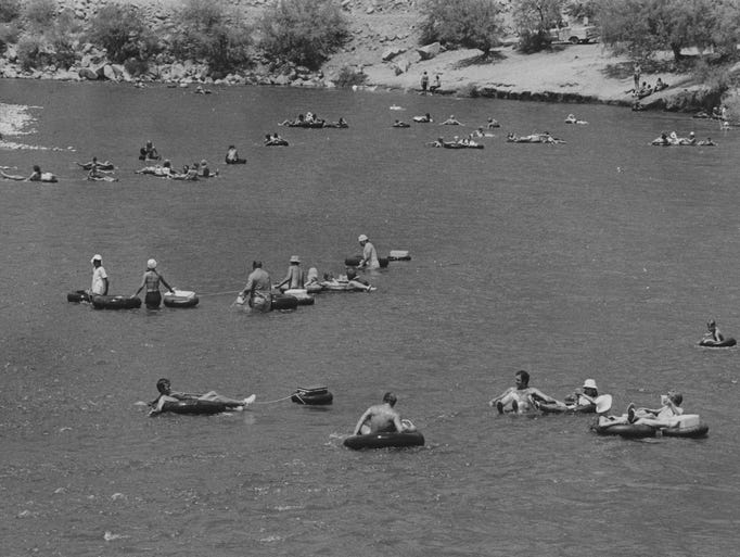 People enjoy a relaxing day on the Verde River in July