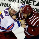 New York Rangers left wing Tanner Glass, left, and Washington Capitals defenseman Tim Gleason (Clawson) fight April 11, 2015, in Washington.