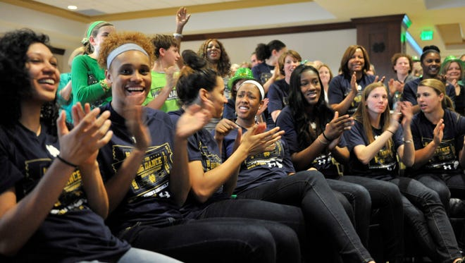 Notre Dame players react during the NCAA college basketball tournament selection show Monday, March 16, 2015, in South Bend, Ind. Notre Dame is the No. 1 seed in the Oklahoma City region. (AP Photo/Joe Raymond)