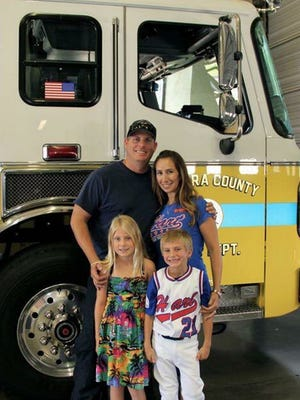 A memorial fund was set up Thursday to help the family of Ventura County fire engineer Ryan Osler, 38, who died when the water tender he was riding in overturned. Olser is pictured with his wife, Jennifer, daughter, Amanda son Brandon.
