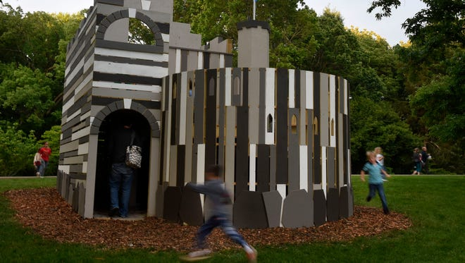 Kids race around a playhouse called the Edinburgh Castle at Cheekwood Botanical Garden.  Cheekwood's new International Playhouses exhibit has six unique designs in the East gardens. Each house represents the architecture of countries the Cheek family visited in the 1920s and '30s, from Scotland to Spain to India.