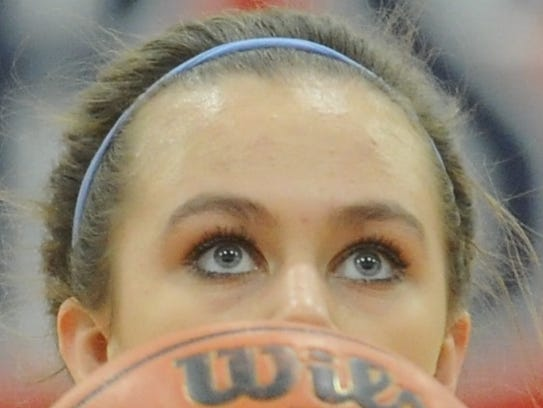 Cooper's Ellie McMillon eyes the basket before shooting