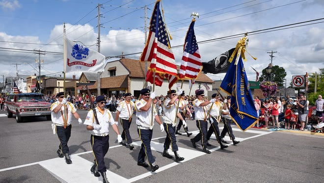 Color guard members lead things off during the Fourth of July parade Monday in St. Joseph.