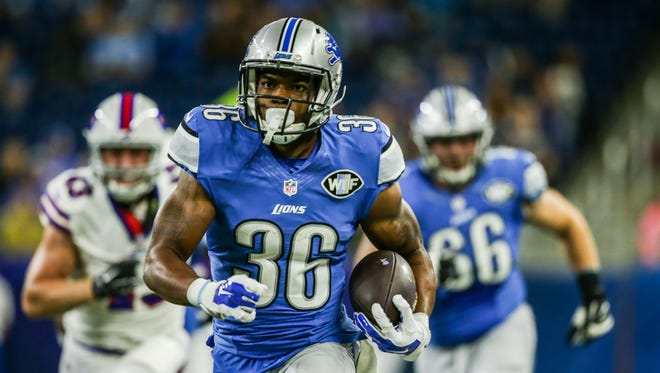 Lions running back Dwayne Washington runs for a 58-yard touchdown in the first quarter against the Buffalo Bills during an exhibition game at Ford Field on Sept. 1, 2016.