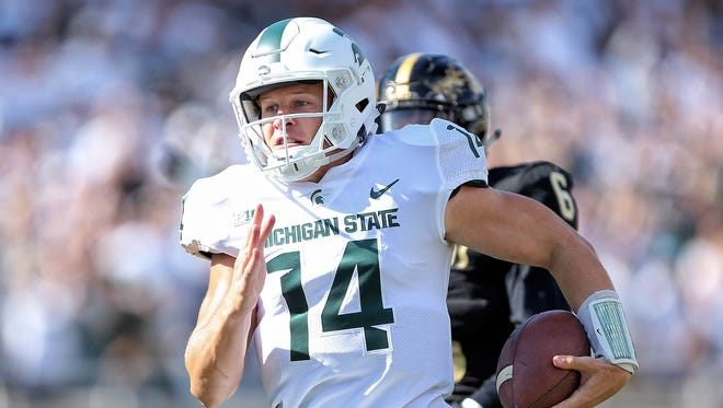 Sep 9, 2017; East Lansing, MI, USA; Michigan State quarterback Brian Lewerke runs for a 61-yard touchdown in the first quarter against Western Michigan at Spartan Stadium.