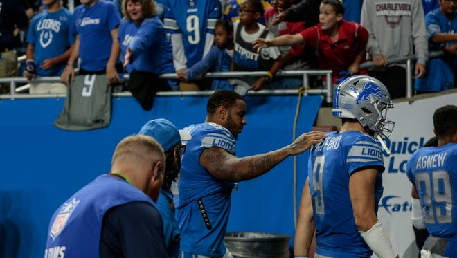 Lions tight end Eric Ebron and quarterback Matthew Stafford walk off the field losing to the Carolina Panthers, 27-24, at Ford Field in Detroit, Sunday, Oct. 8, 2017.