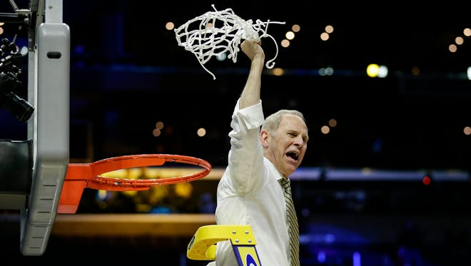 John Beilein celebrates the cutting of the net after Michigan defeated Florida State, 58-54, in the Elite Eight of the NCAA tournament at Staples Center in Los Angeles, Saturday, March 24, 2018.