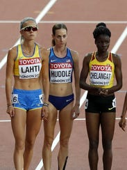 Molly Huddle, center, is pictured with Sarah Lahti,