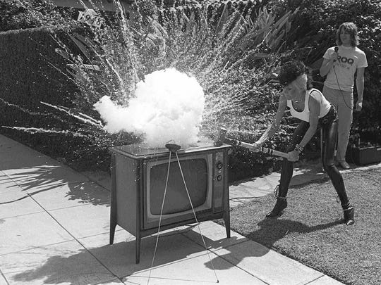 Punk rock star Wendy O. Williams smashes a television set for a radio station contest in Pasadena, California in this June 16, 1981 photo. Williams, a Webster native, will be inducted into the Rochester Music Hall of Fame on Sunday.