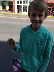Ethan Hill, 9, of Franklin, shows off his shiny new