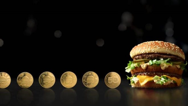 McDonald's Big Mac next to the limited-time MacCoins.