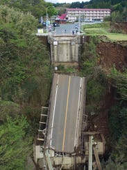 The collapsed Aso Bridge is shown after powerful earthquake