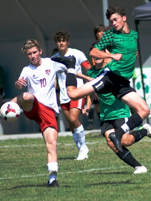 West Branch's Ian Yarwood, right, battles Canfield's Connor Mulichak for the ball during their match on Saturday, August 22, 2020.