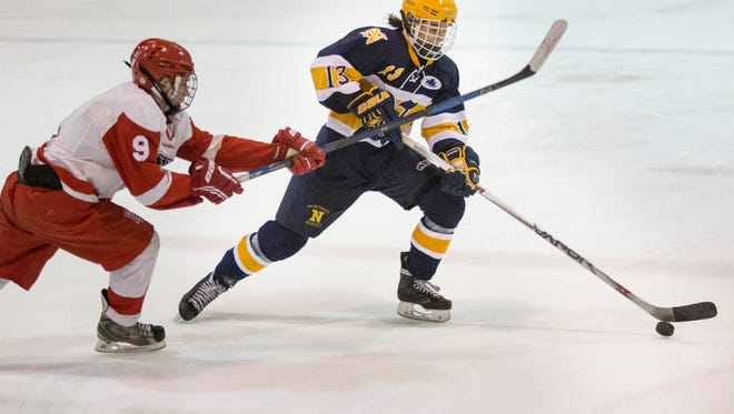 Northern's Corey Easton gets past Port Huron's Jayson Wyrembelski during a hockey game Thursday, Feb. 18, 2016 at McMorran Pavilion. Northern mercied Port Huron 9-1 in two periods.