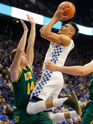 Kentucky Wildcats forward Kevin Knox (5) shoots the ball against Vermont Catamounts guard Cam Ward (14) in the first half at Rupp Arena. Mandatory Credit: Mark Zerof-USA TODAY Sports