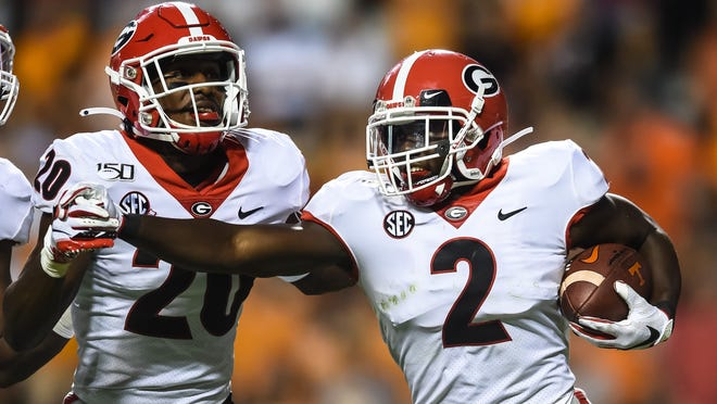 Oct 5, 2019; Knoxville, TN, USA;  Georgia Bulldogs defensive back Richard LeCounte (2) celebrates with defensive back J.R. Reed (20) after intercepting a pass during the third quarter in a game against the Tennessee Volunteers at Neyland Stadium. Mandatory Credit: Bryan Lynn-USA TODAY Sports ORG XMIT: USATSI-404130 ORIG FILE ID:  20191005_lbm_lb6_365.JPG