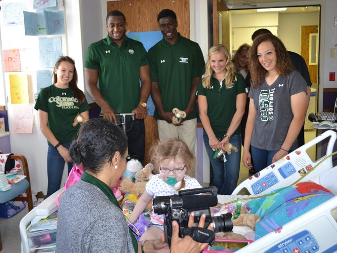 Colorado State athletes visit with patients and staff
