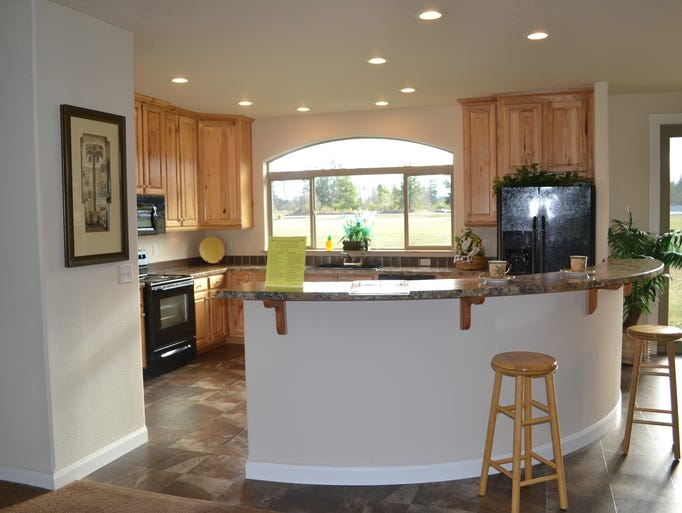 This 2,006-square-foot three-bedroom home includes