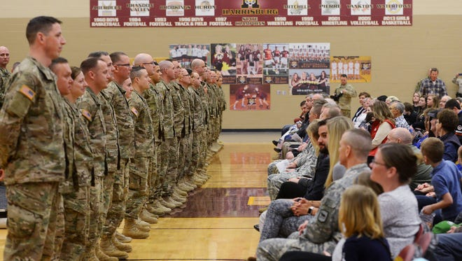 Members of the South Dakota Army National Guard line up as roll is called during a deployment ceremony Saturday at Harrisburg High School, Feb 27, 2016. Thirty-nine members of the 196th Maneuver Enhancement Brigade are being deployed for one year to Kuwait in support of Operation Spartan Shield.