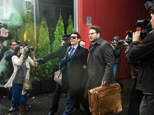 """James Franco, center left, as Dave, and Seth Rogen as Aaron, in Columbia Pictures' """"The Interview."""""""