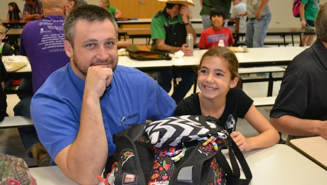 "Jason Davenport enjoys breakfast with his daughter Jacie, during the Yellville-Summit Middle School ""Donuts for Dads"" family breakfast. Nearly 100 family members attended the event scheduled to increase parental involvement in the middle school."