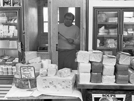 Glenn Hills at the Hills' Home Cured Cheese booth in