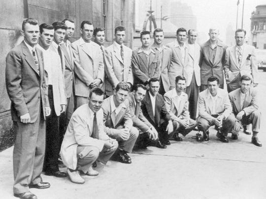 Hardy Peterson with the 1950 Rutgers University College World Series team. Standing (from left): Ted McDonough, Charlie Ruddock, Jim Clark, Allen Willenbrock, George Ruddy, Tom Foster, Peterson, Hal Tindall, George Kaye, Bob Suba, Tex Maskelevich, Herm Hering and George Case; squatting (from left): Don Biehn, Jim Monahan, Dudley Eppel, Julie Lebott, Ray Van Cleef, Alan Stull and Steve Kalapos.