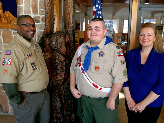 Nicholas Marinelli (center) with Boy Scouts district executive Jerome Townsend (left) and mom Fiona Marinelli