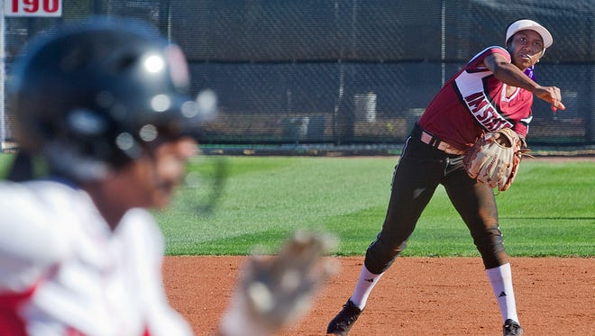 New Mexico State shortstop Rachel Rodriguez makes the throw to first and beats the runner for the out against Seattle Saturday afternoon at the NMSU Softball Complex.