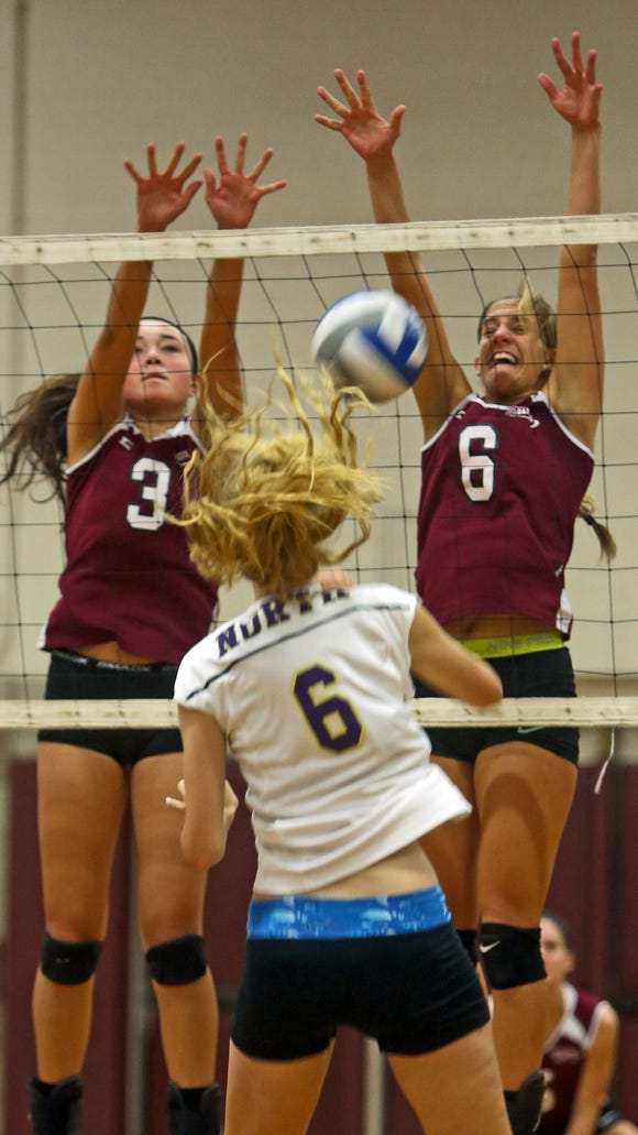 Scarsdale's Tatiana Tiangco, left, and Kristine Fink block a shot by Clarkstown North's Kelly Chaney during a Section 1 Class AA quarterfinal volleyball match at Scarsdale High School Oct. 28, 2014. Scarsdale defeated in Clarkstown North 25-17; 25-15; 20-25; and 25-21.