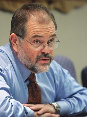 V. John White