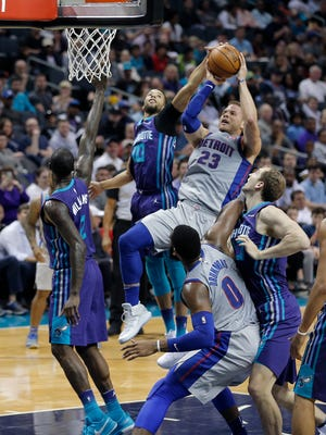 The Charlotte Hornets' Michael Carter-Williams (10) blocks a shot by the Detroit Pistons' Blake Griffin during the first half.