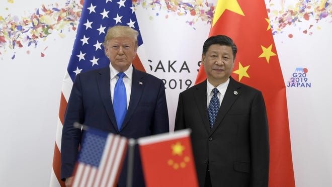 President Donald Trump  posed for this 2019 photo with Chinese President Xi Jinping during a meeting on the sidelines of the G-20 summit in Osaka, Japan.
