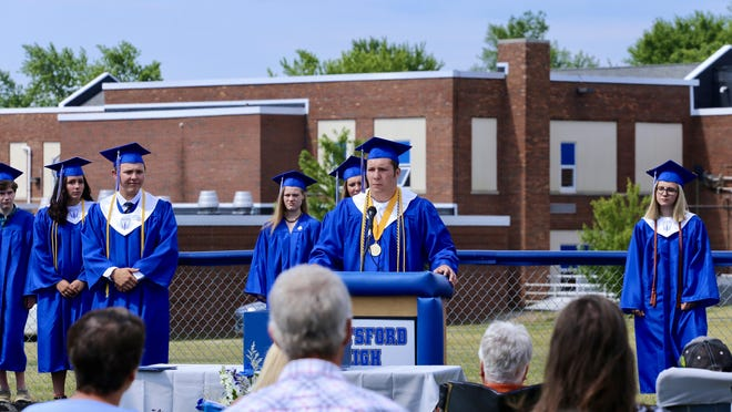 Pittsford High School Valedictorian Kimball Hughes delivers a speech during a commencement ceremony July 12.