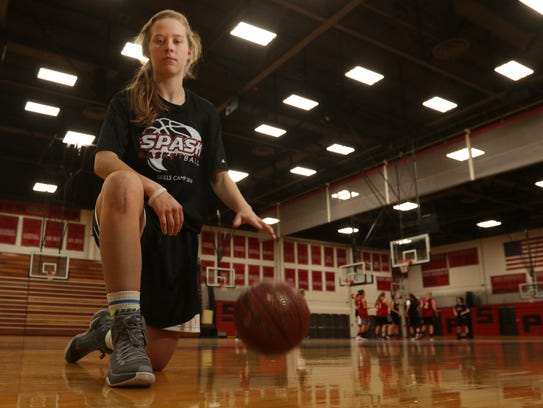 Maggie Negaard, a SPASH girls' basketball star, dribbles