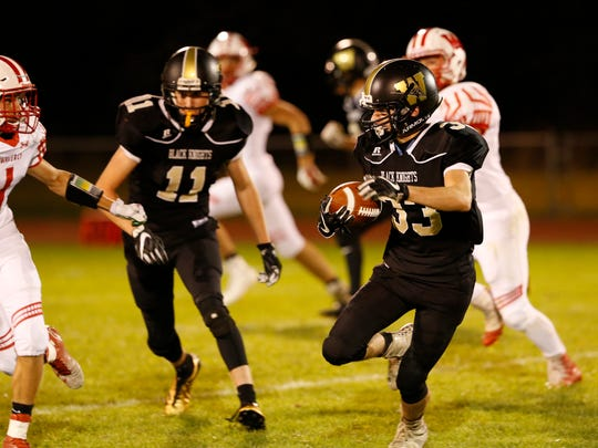 Windsor's Zach Adornato carries the ball during Friday night's game against Waverly. Adornato gained 63 yards, but the Black Knights lost, 14-7.