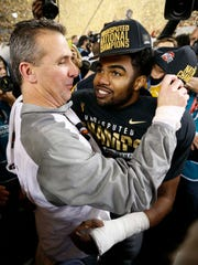 Ohio State coach Urban Meyer (left) and running back Ezekiel Elliott (right) embrace following the Buckeyes' 42-20 win over Oregon in Monday night's national championship game. Ohio State won the inaugural College Football Playoff as the No. 4 seed.