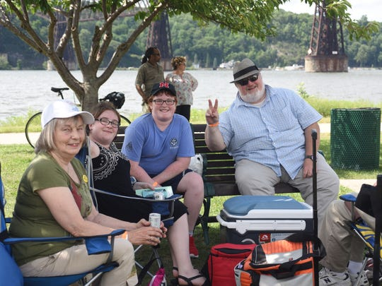Patti Melita of Troy, Jordan McCann, 14, Henry McCann, 12, and Bill McCann, 51, traveled from Schenectady County for the 16th Annual Jazz in the Valley concert at Victor C. Waryas Park in the City of Poughkeepsie Sunday.