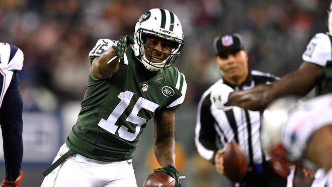 New York Jets wide receiver Brandon Marshall (15) signals a first down after a reception. New York Jets and the New England Patriots are tied 10-10 at the half at MetLife Stadium on Sunday, November 27, 2016.