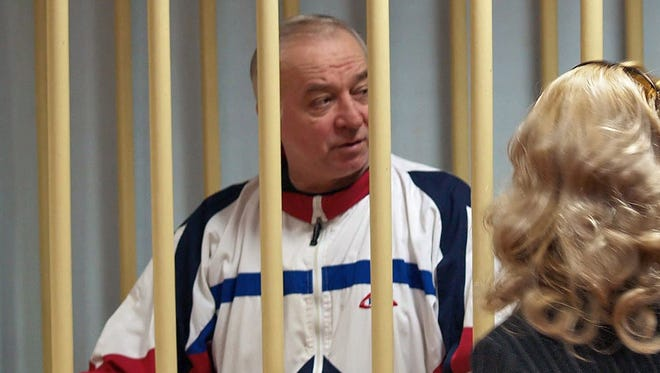A photo dated Aug. 9, 2006 shows Sergei Skripal talking from a defendants cage to his lawyer during a hearing at the Moscow District Military Court in Moscow, Russia