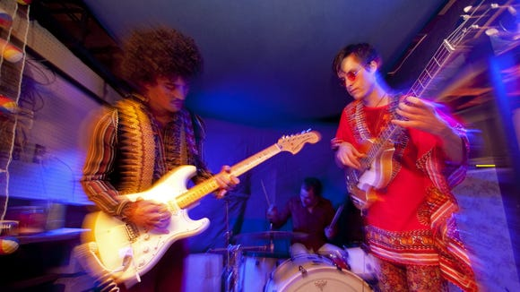Tail practices for a Halloween concert in 2011 where they performed the songs of The Jimi Hendrix Experience.