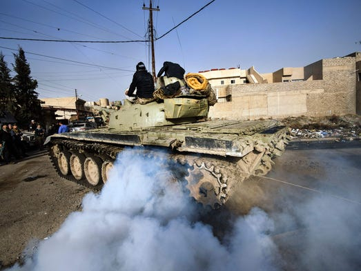 An Iraqi army T-72 tank heads to the frontline during