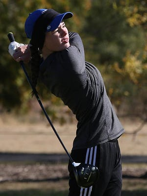 Hutchinson's Reaghan Martin tees off on hole #3 during the Class 6A Golf State Championship at Carey Park, Tuesday, Oct. 22, 2019.