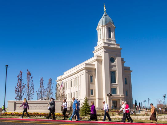 People visit the Cedar City LDS Temple on the first