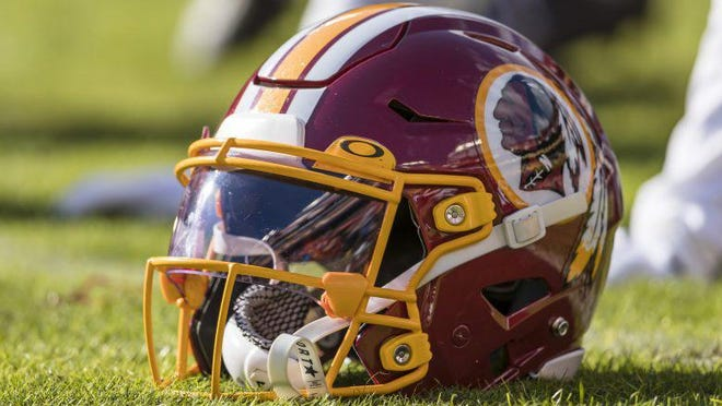 A Washington Redskins helmet is seen on the field before the game between the Washington Redskins and the Philadelphia Eagles at FedExField on December 15, 2019 in Landover, Maryland.