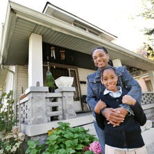 Lisa Hardy, along with her 8-year-old daughter, Leah Jones, has lived rent-free for about eight years in an Indianapolis house that was abandoned by its investor-owner.