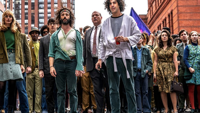 Jerry Rubin (Jeremy Strong), Dave Dellinger (John Carroll Lynch), and Abbie Hoffman (Sacha Baron Cohen) get ready to lead protestors through Chicago.