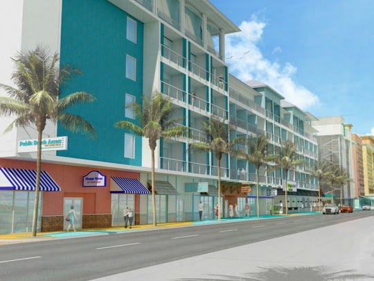 A conceptual rendering shows the four hotels with ground-level retail proposed by Torgerson Properties.