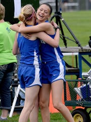 Tessa Hosford, right, and Annie Fanta embrace after helping Bath win the 3,200 meter relay during Friday's Division 3 regional at Bath.